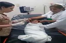 خارج کردن سکه از گلوی کودک توسط پزشک زبردست