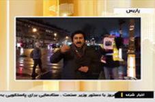 پوستر حاج قاسم سلیمانی در دست معترضان جلیقه زرد پاریسی