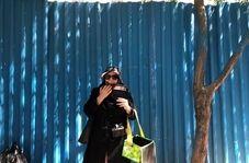 فلوت نوازی یک زن در راسته بازار تهران