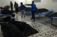 حال و هوای سردخانه فرودگاه بغداد و وداع با پیکر شهدا