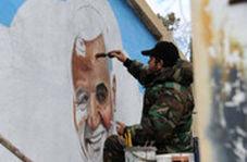نقاشی چهره شهید حاج قاسم سلیمانی روی دیوار روبروی حرم حضرت زینب(س)