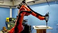 رباتی که با دیدن چهره افراد، تصویر آنها را روی پارچه میدوزد!
