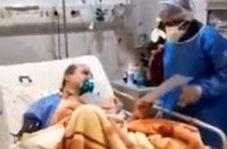 ویدئویی از پزشک مبتلا به کرونا که از روی تخت ، مریض ویزیت میکند