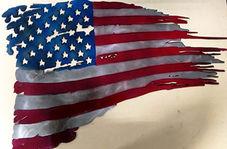 حرکت جالب مردم در پاک کردن کفش خود با پرچم آمریکا + فیلم
